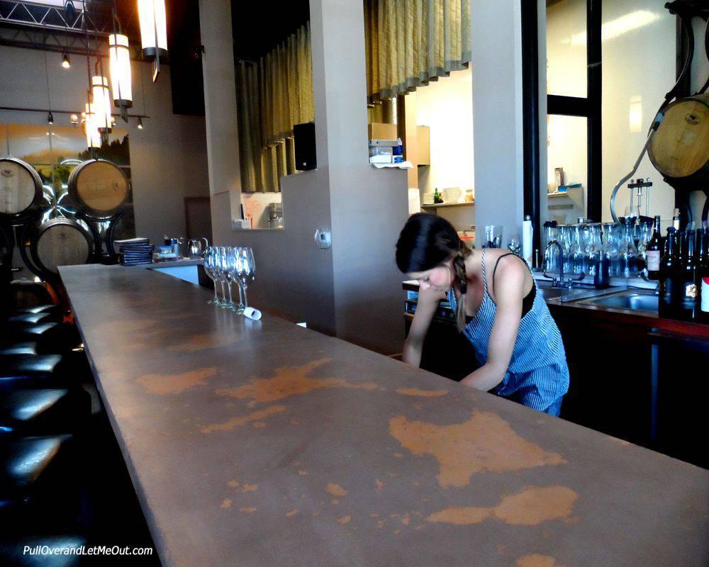 bar tender working behind a bar