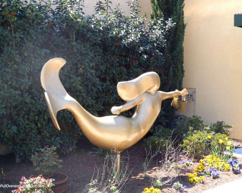 a gold mermaid statue
