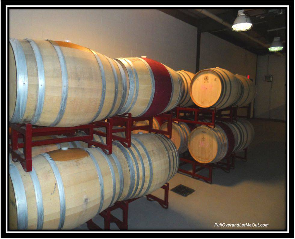 oak wine barrels in the barrel room at Early Mountain Vineyards