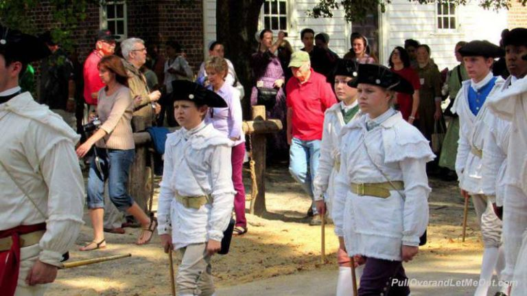 A fife and drum band marching through Colonial Williamsburg
