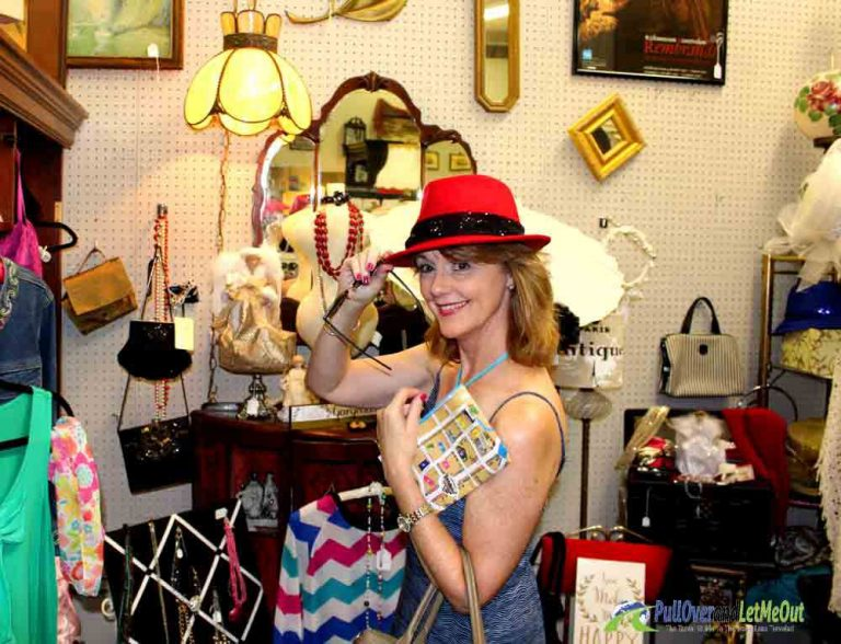 woman trying on a red hat