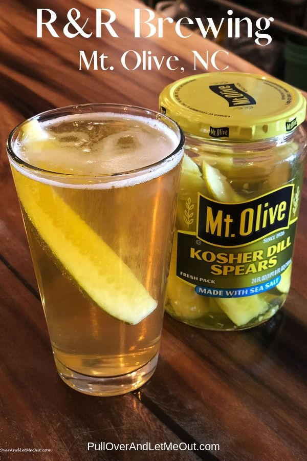 An icy cold Pickletown Lager in a glass served with a pickle at R&R Brewing Microbrewery and Taproom in Mount Olive, NC. PullOverAndLetMeOut.com