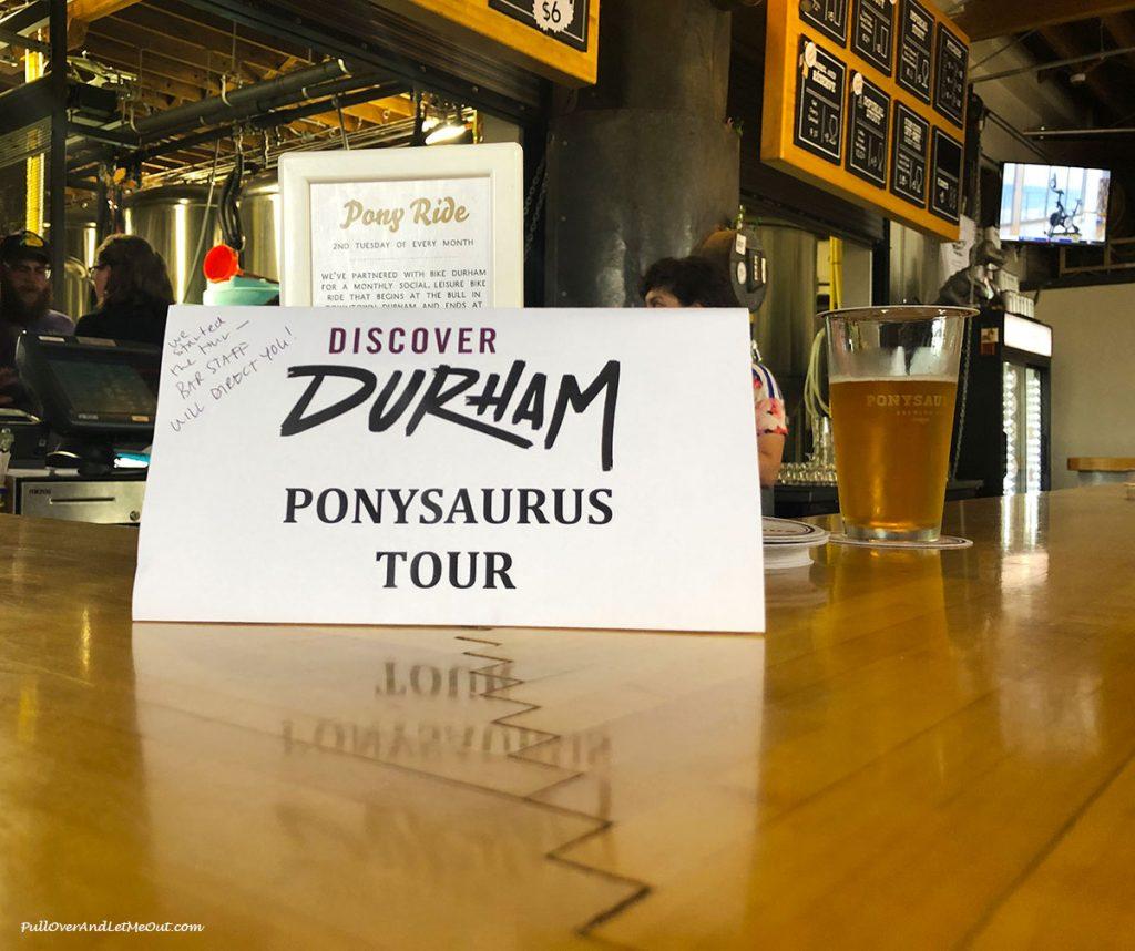 Ponysaurus Tour sign on the bar at Ponysaurus Brewing Durham, NC PullOverAndLetMeOut.com
