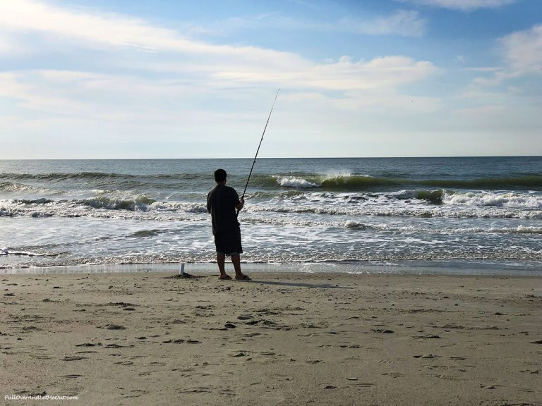 Fishing in the Atlantic on the beach outside The Strand Hotel in Myrtle Beach. PullOverAndLetMeOut