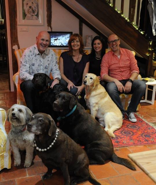 A family with several dogs. Trusted House Sitters PullOverAndLetMeOut.com
