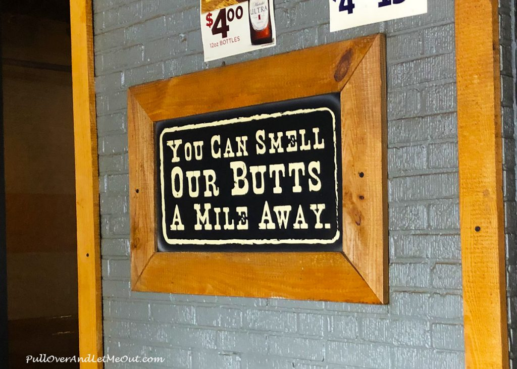 Sign that says You Can Smell Our Butts A Mile Away. PullOverAndLetmeOut