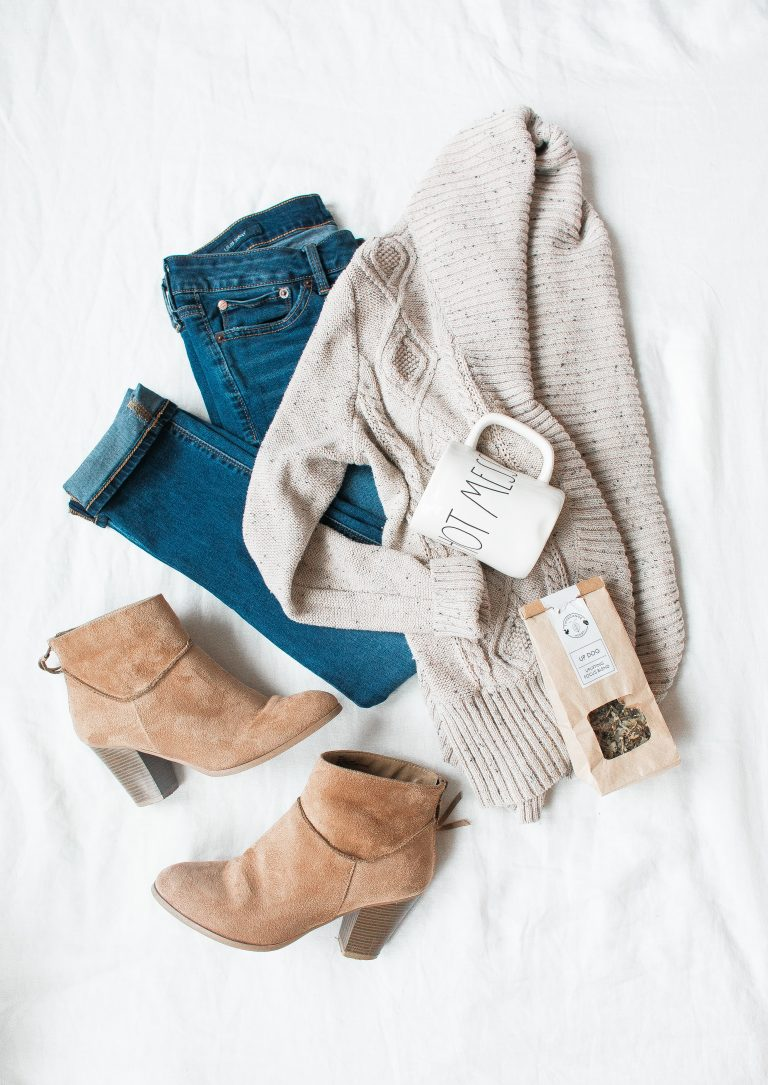A picture of a pair of jeans, sweater, and demi boots.