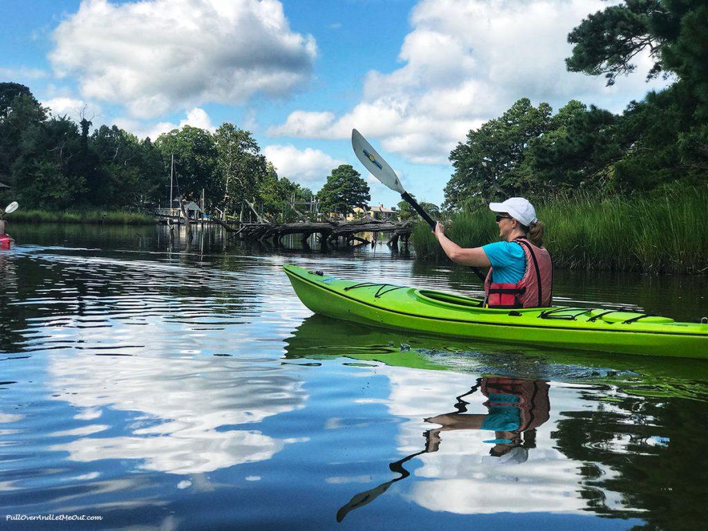 Woman in green kayak.