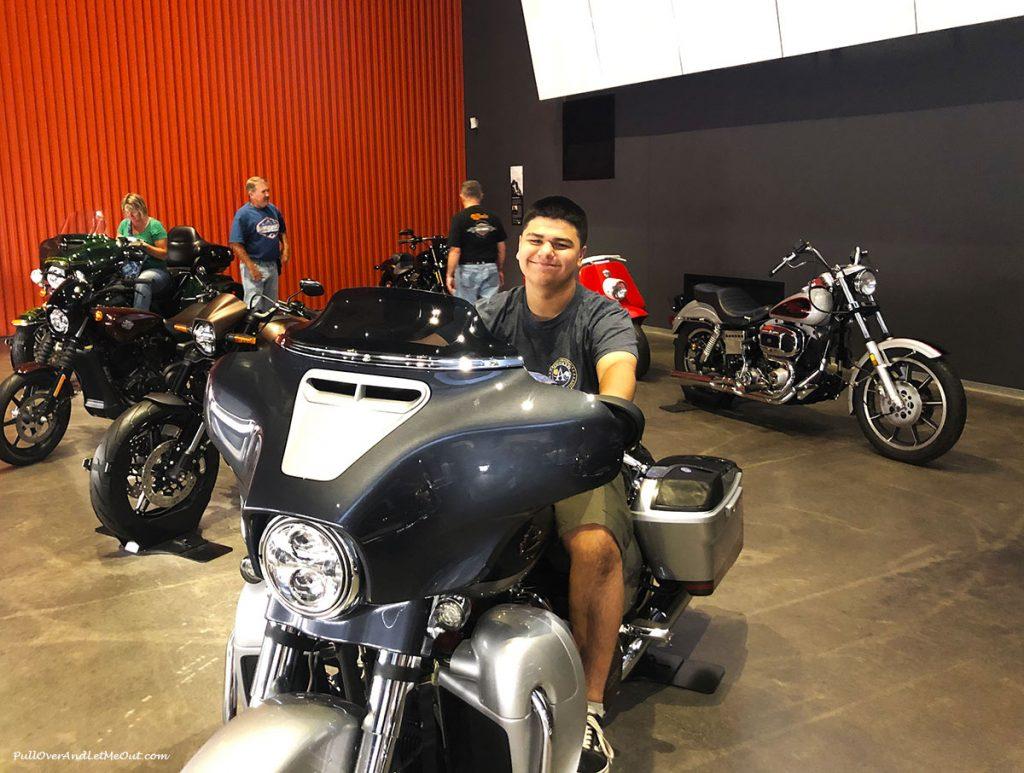 Guy sitting on a Harley-Davidson. PullOverAndLetMeOut