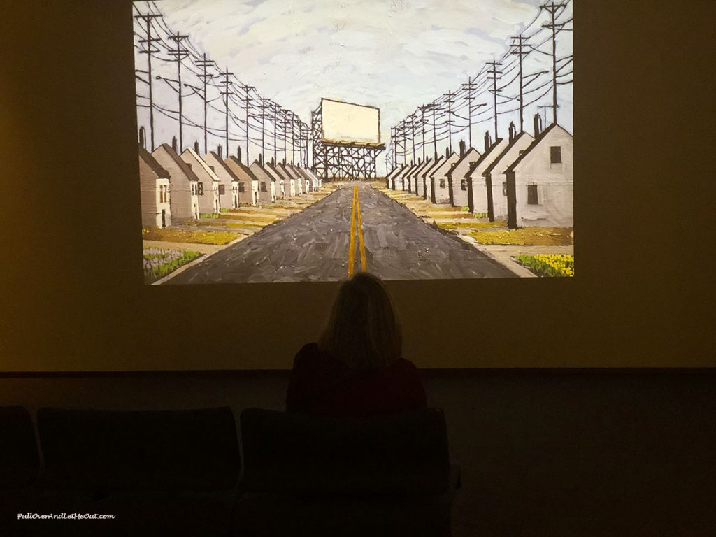 Woman sitting in front of a video screen