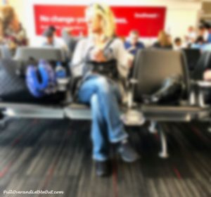 woman in airport waiting area.