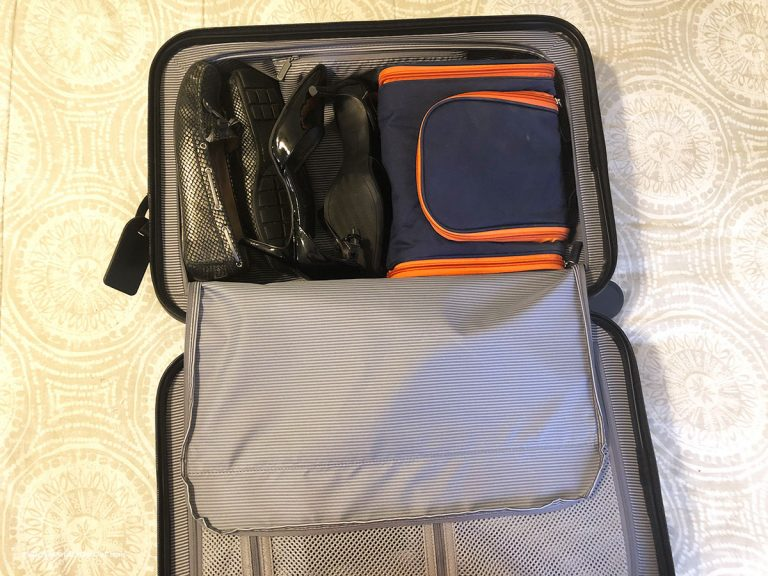 Shoes and toiletry bag in carry-on suitcase