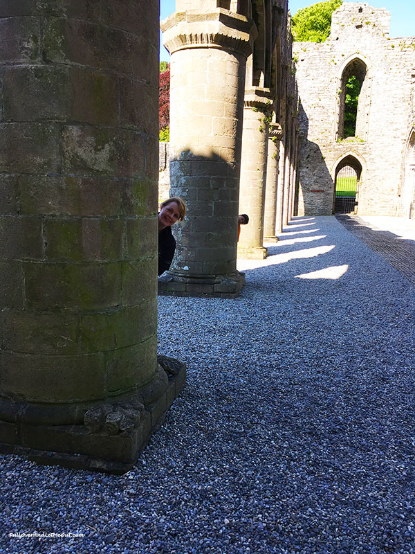 People peeking from behind poles at Boyle Abbey in Ireland. PullOverandLetMeOut