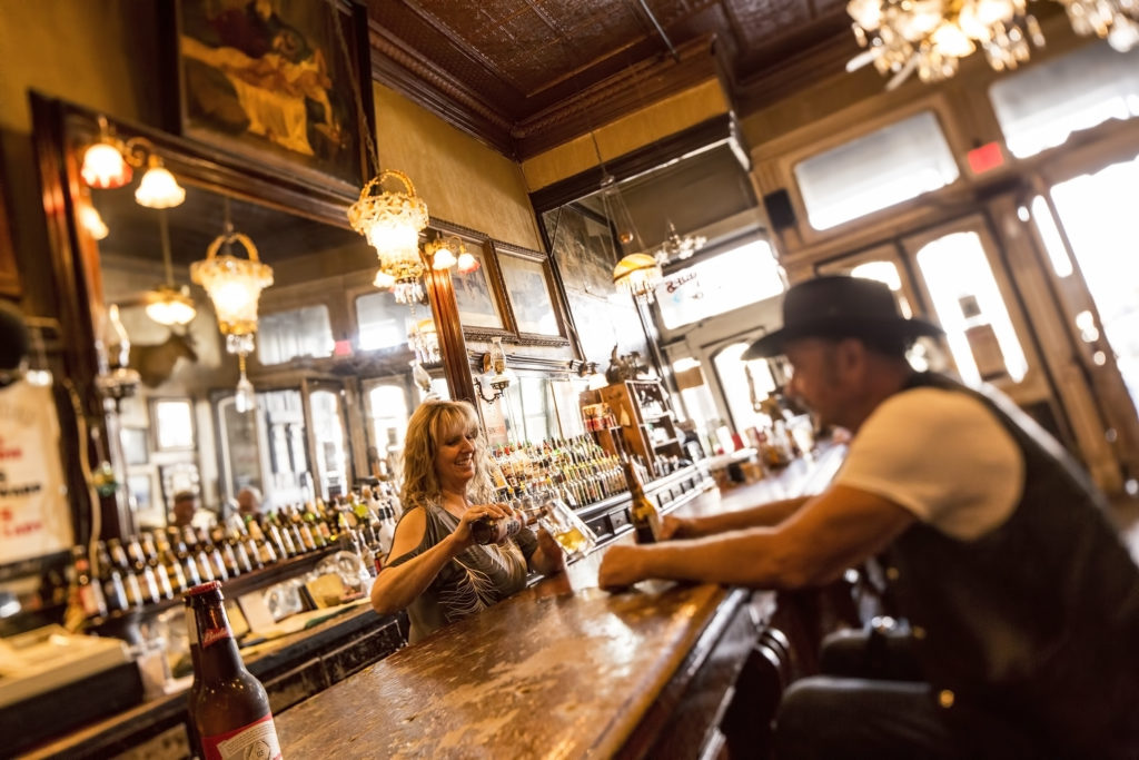 bar tender and patron at a bar in Virginia City, Nevada PullOverAndLetMeOut