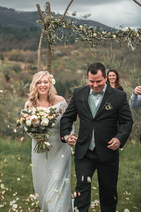 A bride and groom after the ceremony in Tuscay, Italy - PullOverAndLetMeOut