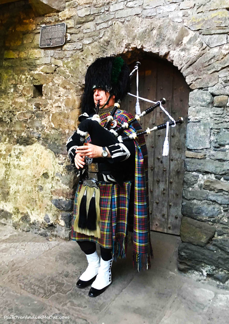 A bagpiper in front of Bunratty Castle
