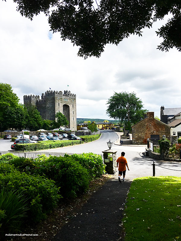 Boy walking to Bunratty Castle in Ireland