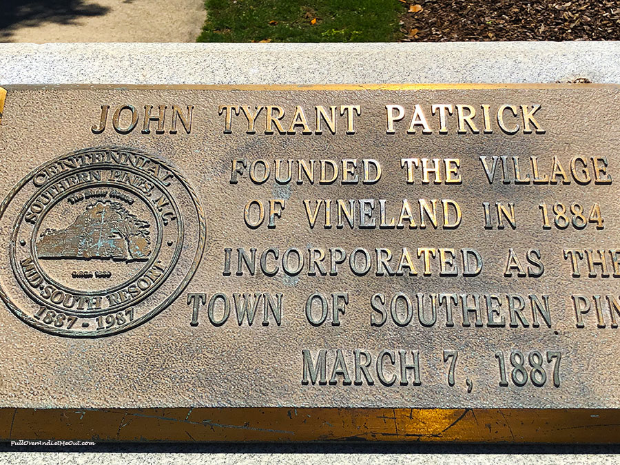 A brass plaque with the name John Tyrant Patrick