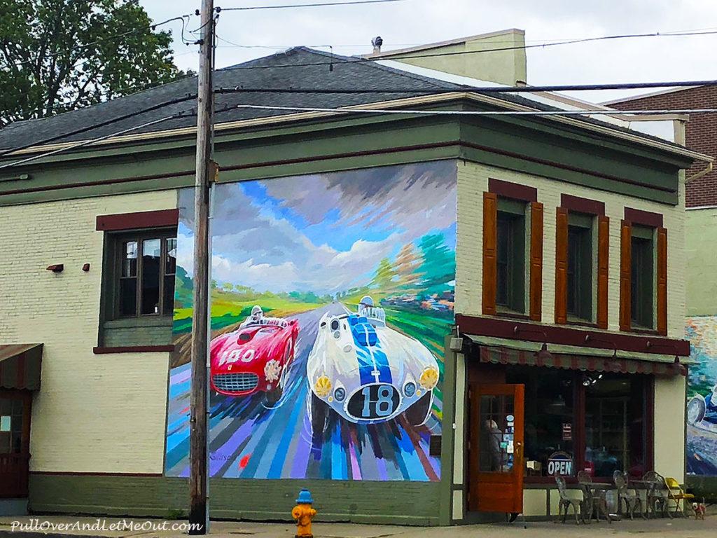Street art of race cars on a building in Watkins Glen, NY