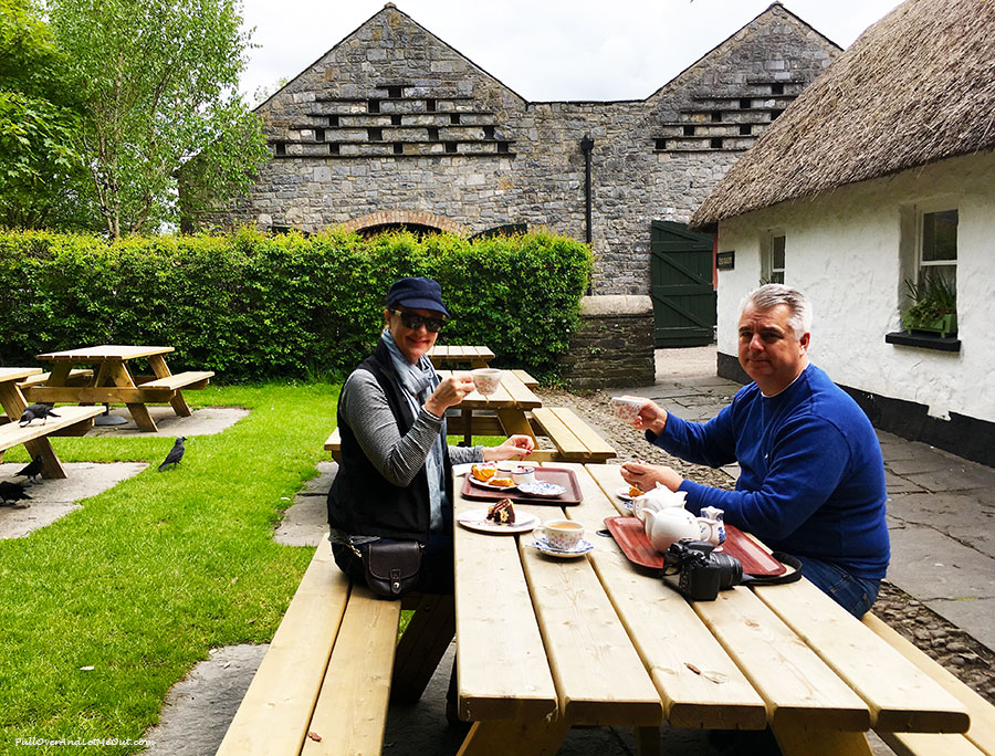 couple drinking tea and eating scones at Bunratty Castle and Folk Park