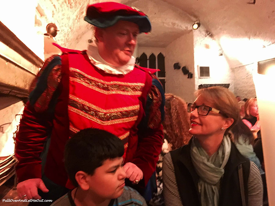 A man in Medieval costume speaking to diners at Bunratty Castle's Medieval Banquet