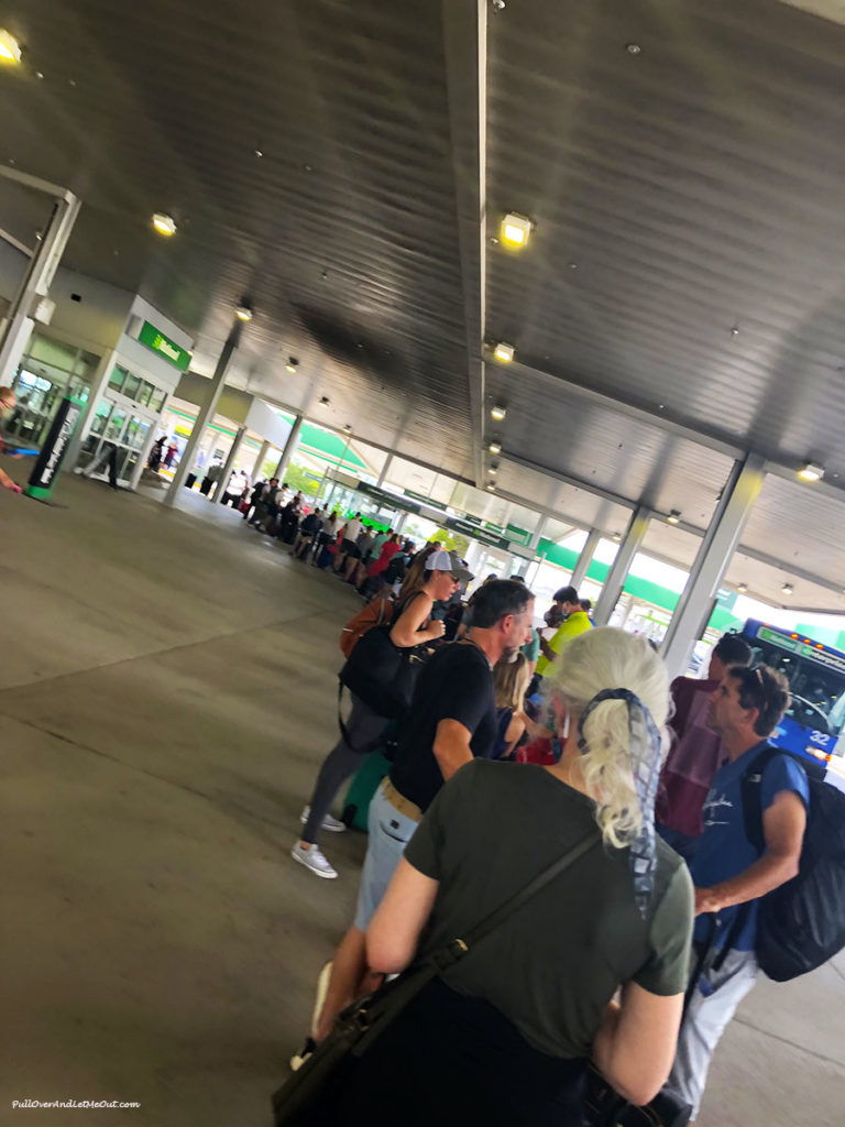 a long line at a rental car pickup location