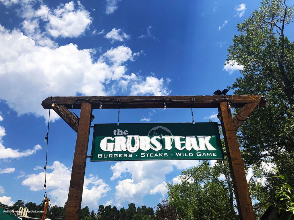 Grubsteak restaurant sign