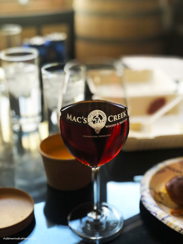 A glass of wine in a Mac's Creek wine glass