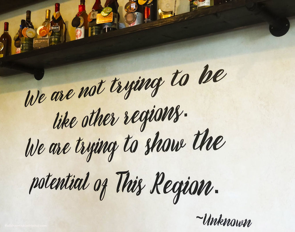 a wine quote on a wall
