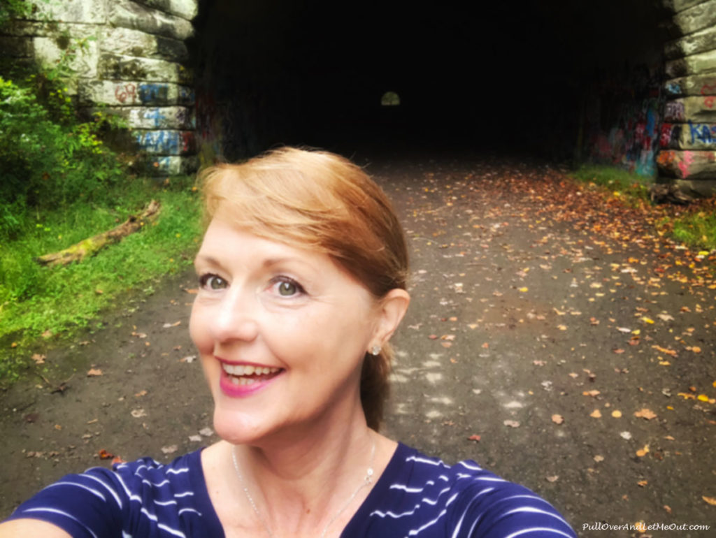 Woman taking selfie in front of a tunnel on the Road to Nowhere Bryson City, NC PullOverAndLetmeOut