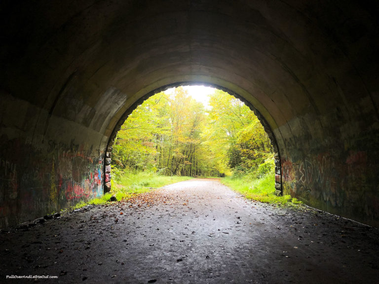 Inside a tunnel looking out at trees. Road to Nowhere Bryson City, NC PullOverAndLetMeOut