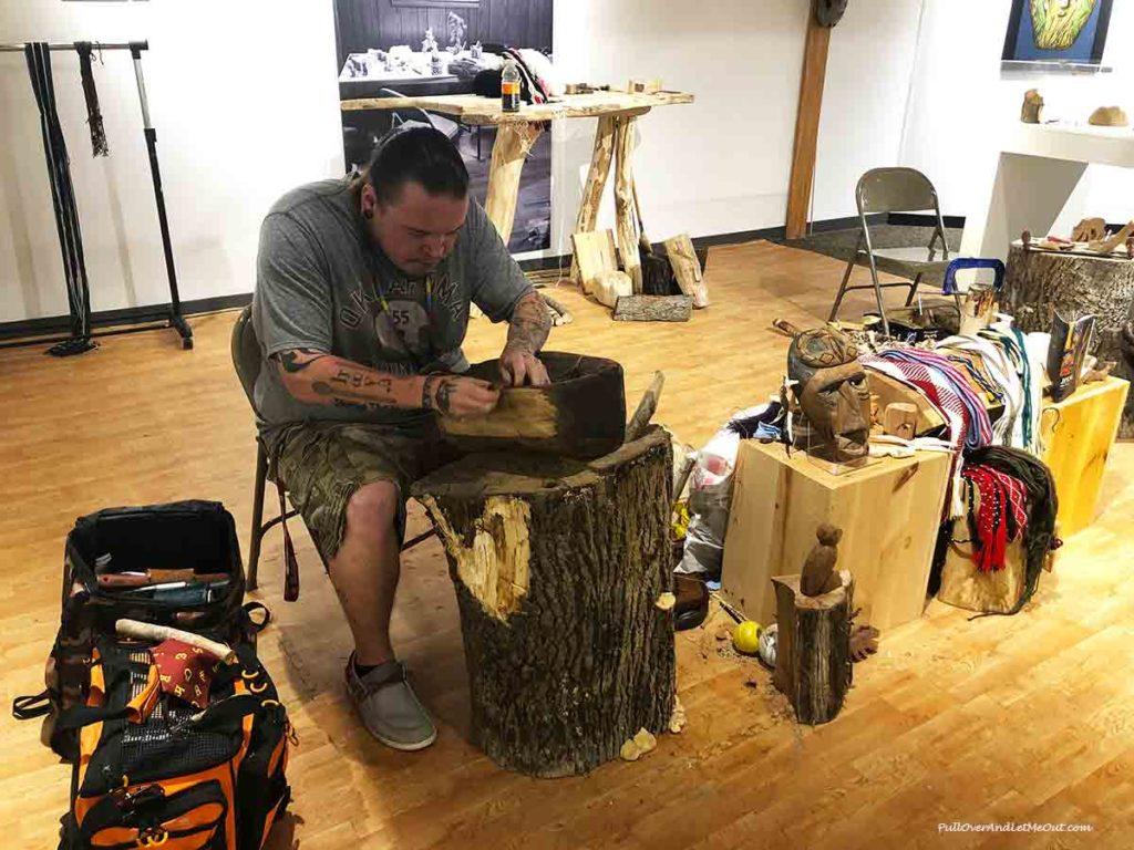 Cherokee craftsman carving wooden mask. PullOverAndLetMeOUt