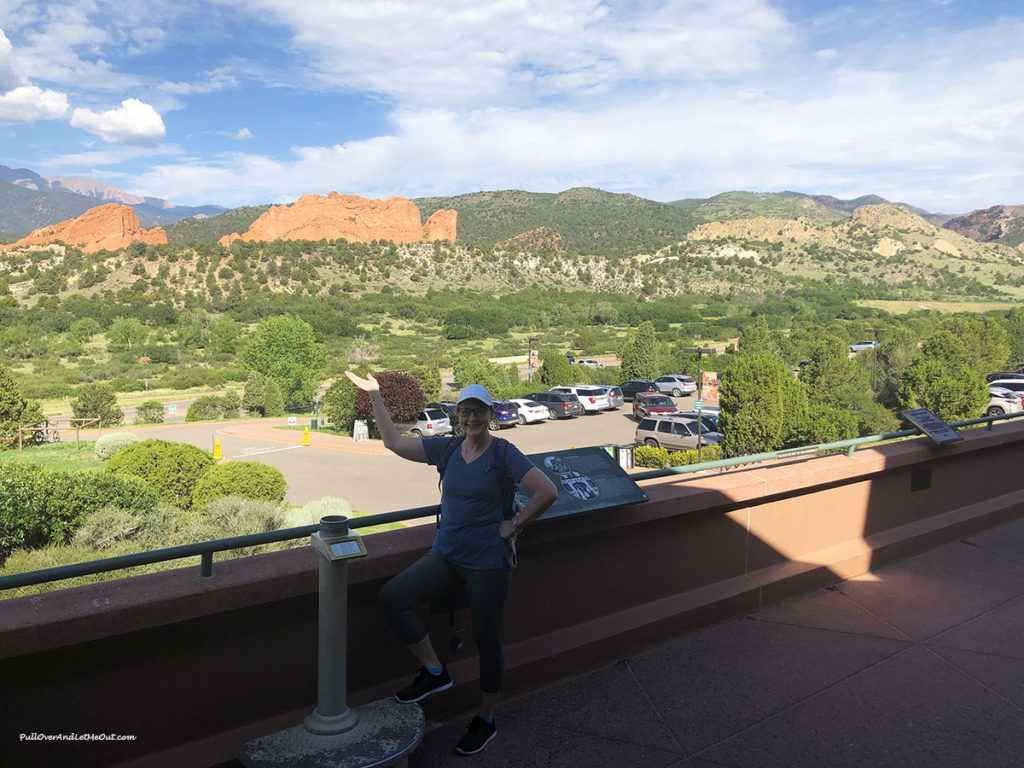 woman on the balcony of the Garden of the Gods Visitor and Nature Center
