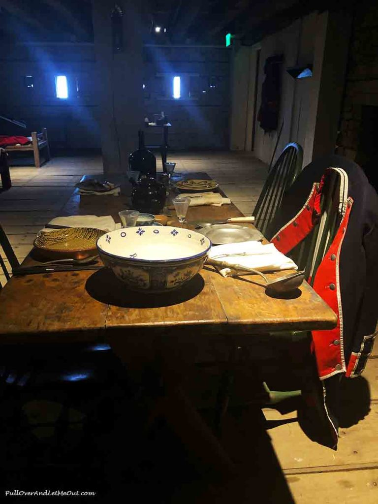 A table set with colonial style dishes