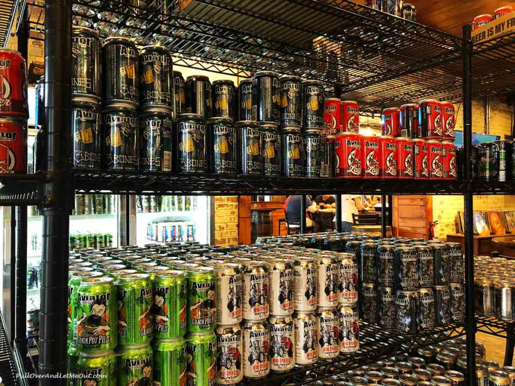 stacks of beer cans to purchase at Aviator Brewing Co. in Fuquay-Varina, NC PullOverAndLetMeOut