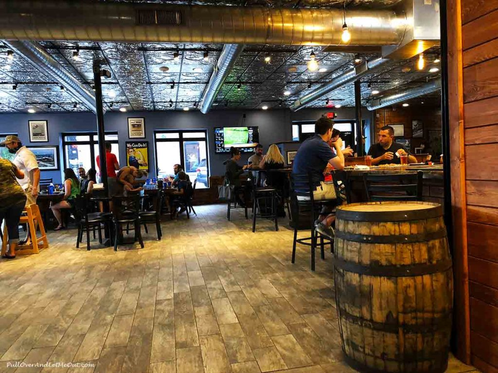 People sitting at a bar at Aviator Brewing Co. in Fuquay-Varina, NC PullOverAndLetMeOut