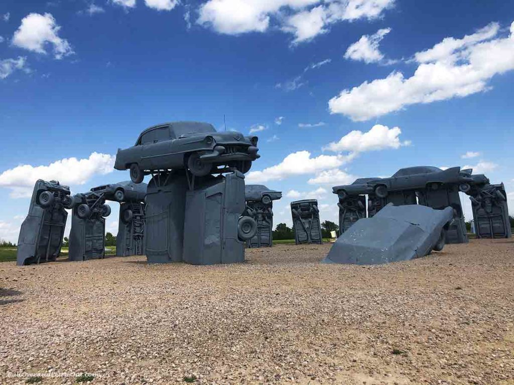 cars stacked to form stonehenge called carhenge