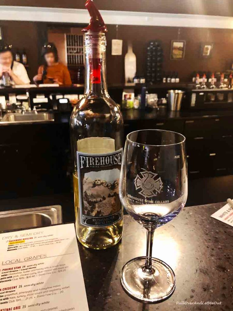 Bottle of wine and a glass at Firehouse Wine Cellars