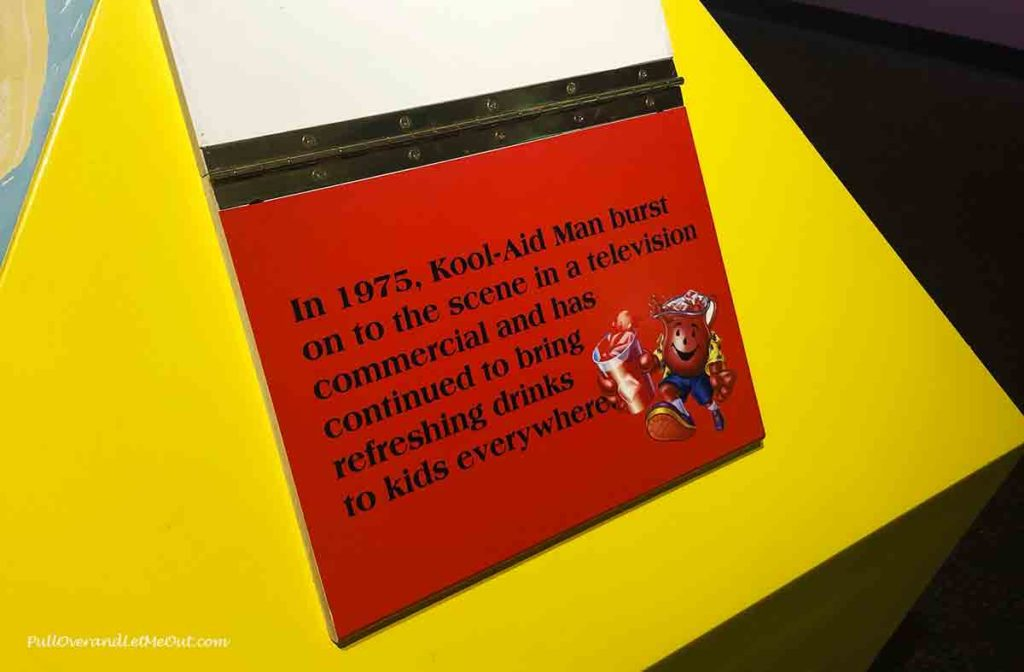 A plaque in the Kool-Aid Museum stating when the Kool-Aid Man first appeared