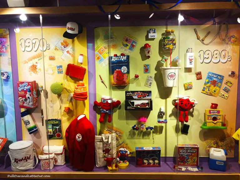 A display case with Kool-Aid swag