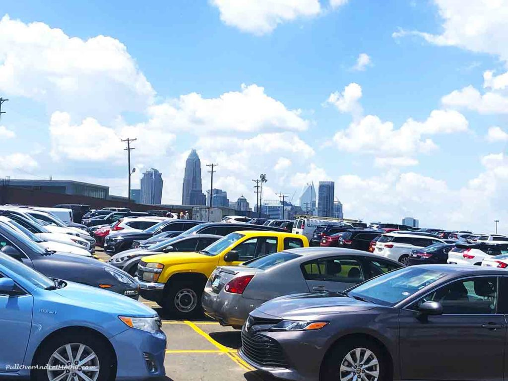 parking lot in shadow of downtown Charlotte, NC