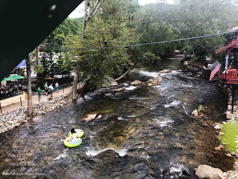 Two people riding intertubes on the Chattahoochee River in Helen, GA